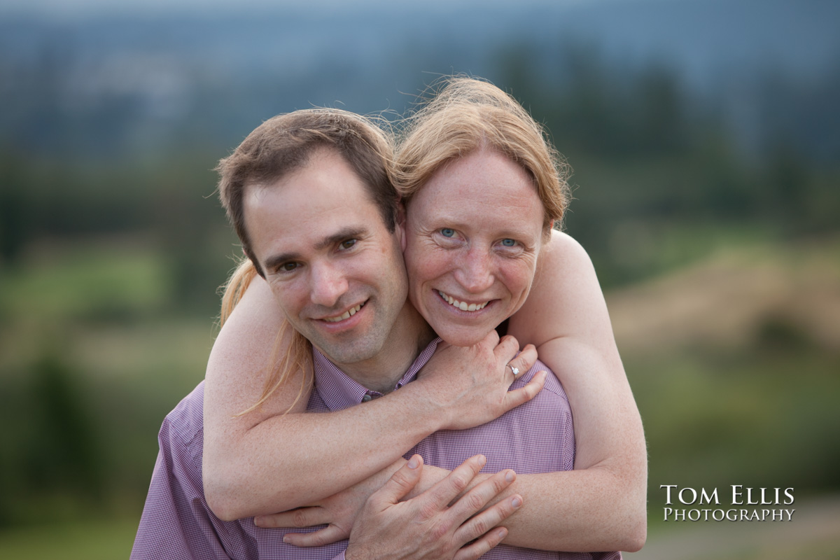 Rene gives Dan a big hug during their engagement photography session at Newcastle Golf Club