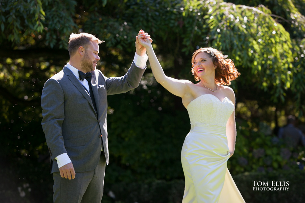 Shiela and Timothy share a quick dance before their Seattle wedding at Parson's Garden