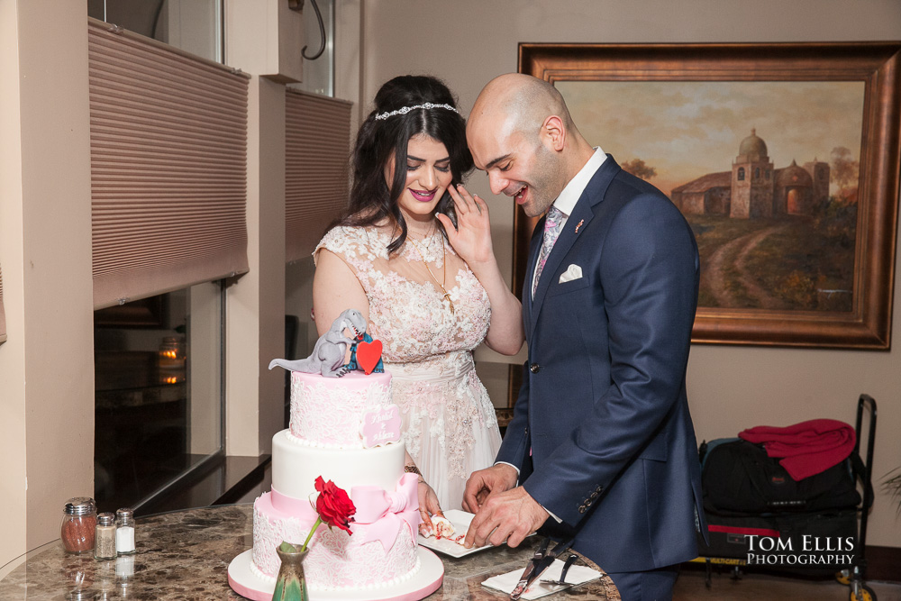 Ahlam and Khalid cut their engagement cake during their Seattle area engagement party