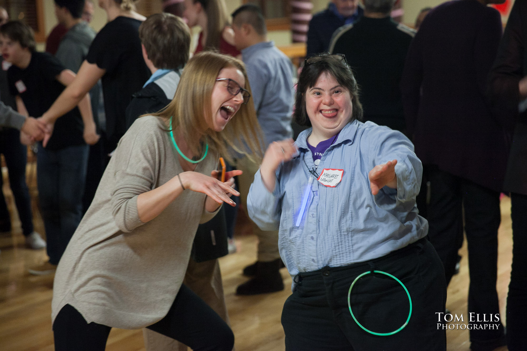 Two girls dancing at the 2016 Down Syndrome Community Sweetheart Dance