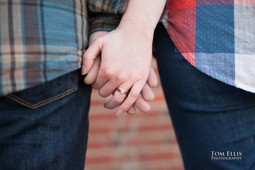 Close up photo of engaged couples hands and engagement ring