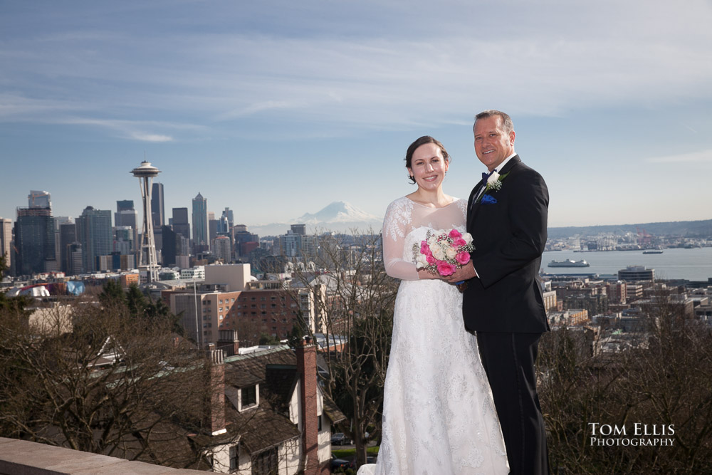 Bride and groom at Kerry Park in Seattle, with the Seattle Center, Space Needle and Mt Rainier in the background