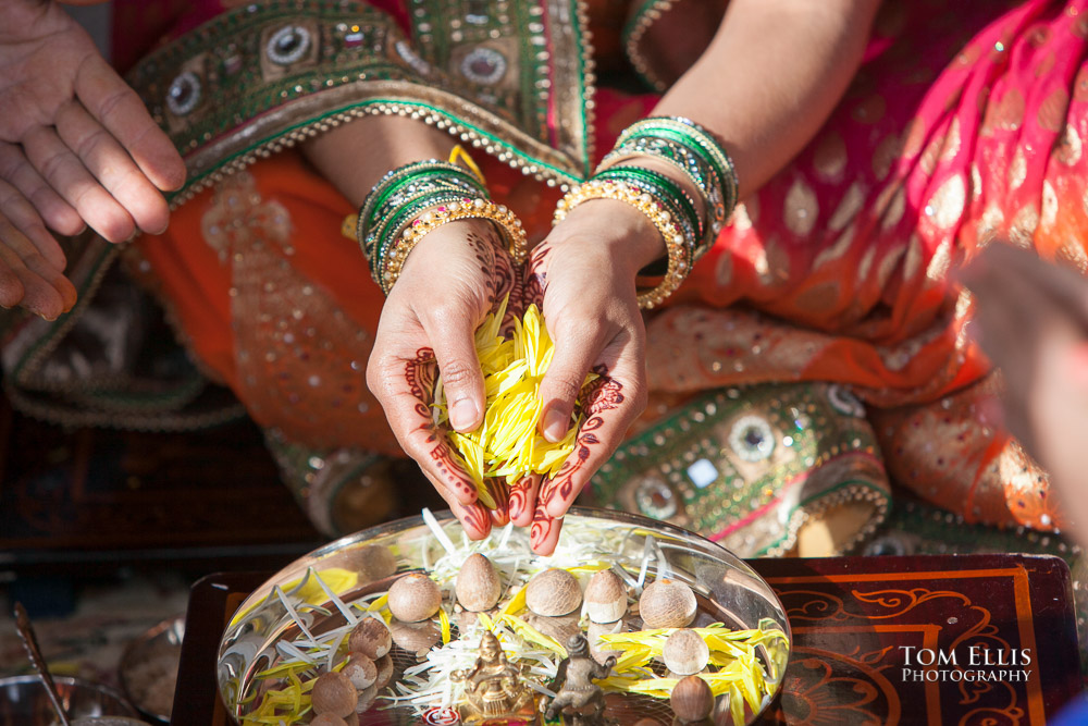 Close up photo of bride's hands during a traditional Indian wedding ceremony