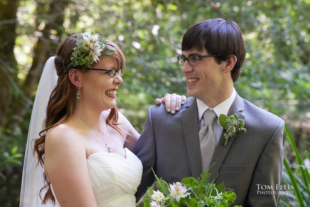 close up photo of bride and groom in the deep woods