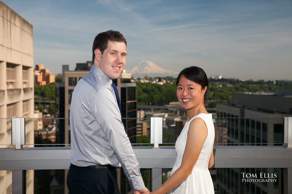 Bride And Groom Turn To Face The Camera At Their Seattle Courthouse Wedding With Mt