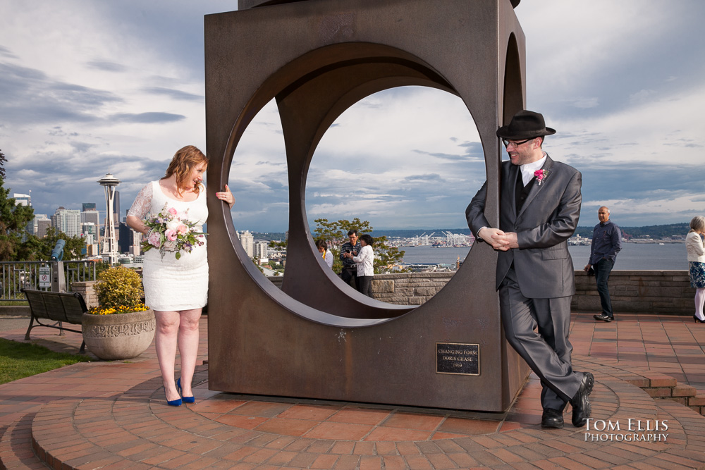 Newlywed couple pose for a photo at Kerry Park after their elopement wedding ceremony at the Seattle Municipal Courthouse