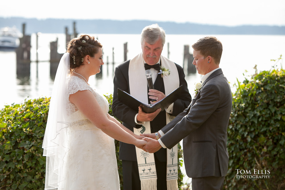 Julika and Jess giving their wedding vows at their same-sex wedding ceremony at Ballard Bay Club in Seattle