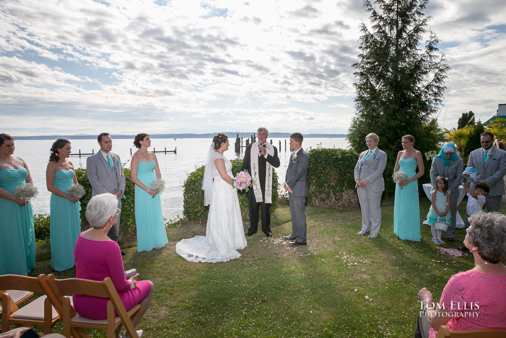 Same sex wedding ceremony at beach venue, Puget Sound in the background