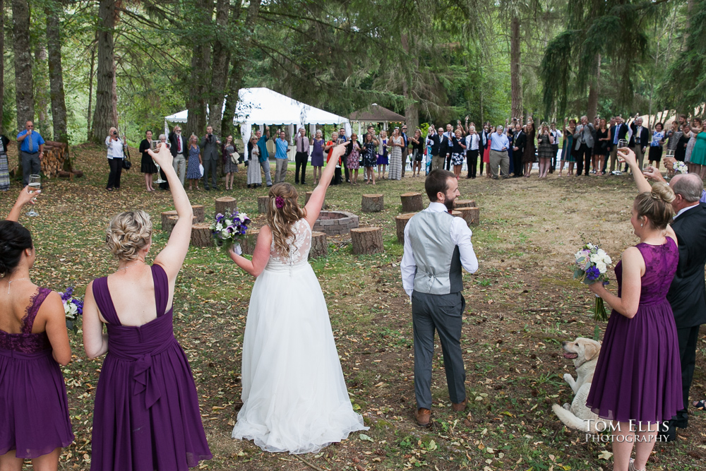 Bride, groom, wedding party and guests gather in a large circle after their wedding ceremony at the Kingston House