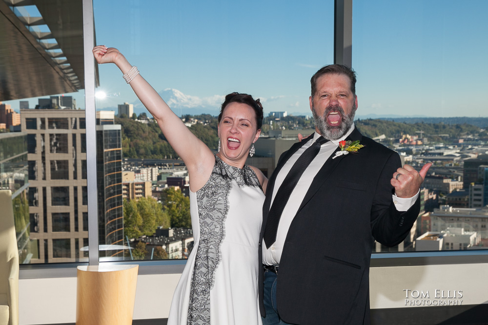 Bride and groom celebrate after the completion of their wedding ceremony at the Seattle Municipal Courthouse