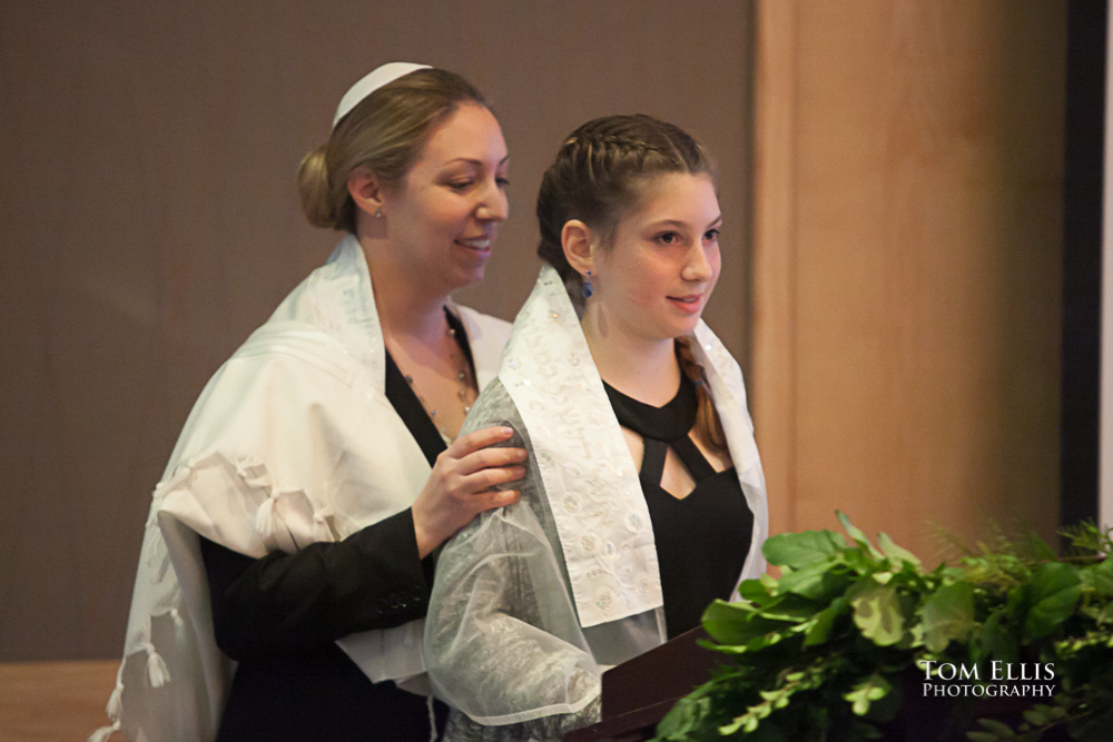Young girl with her rabbi as they begin her Bat Mitzvah ceremony in Seattle