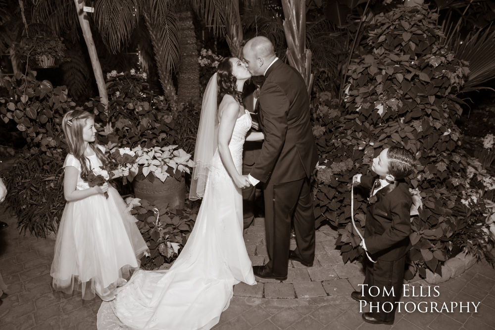 Bride and groom kiss at the conclusion of their wedding ceremony at the Seymour Conservatory in Wright Park