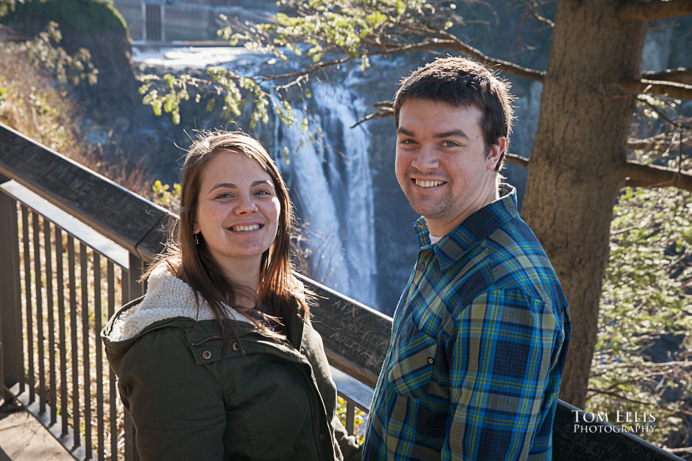 Engagement photo of couple with Snoqualmie Falls in the background