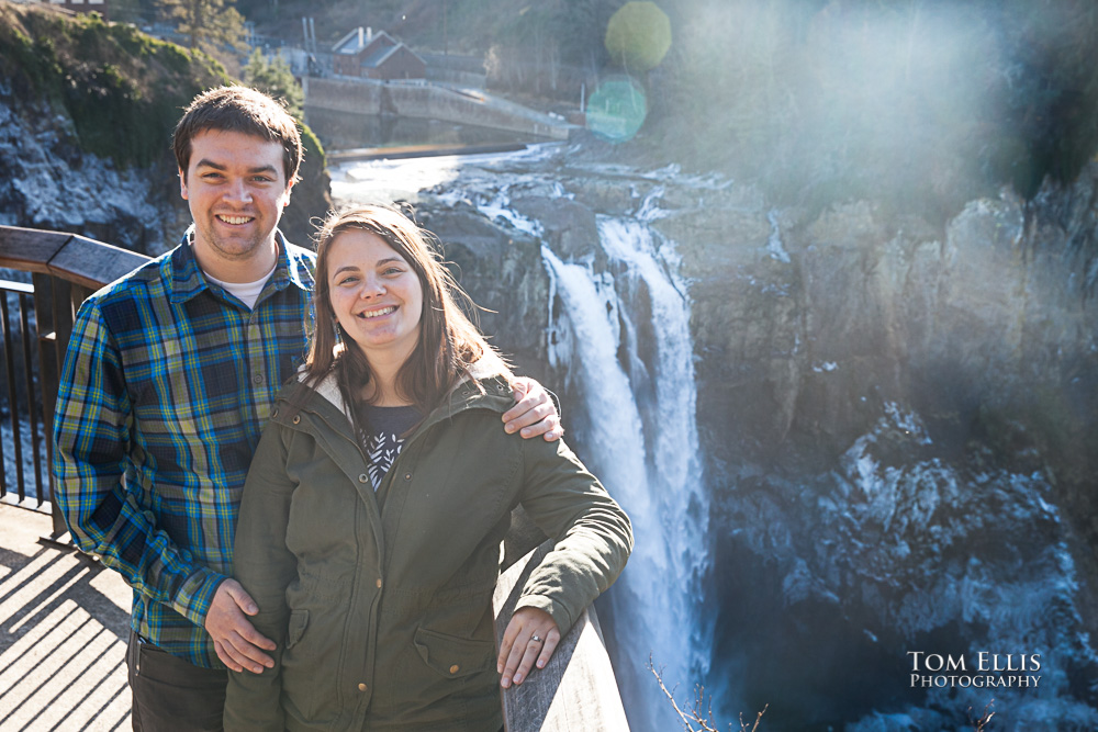 Engagement photo at Snoqualmie Falls with Falls and icy spray in background