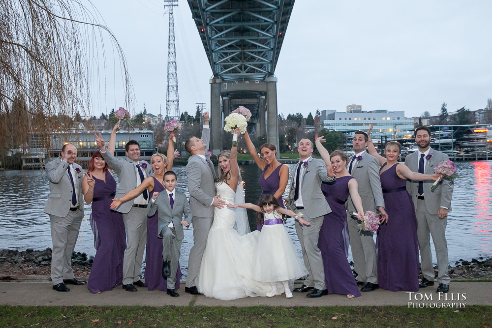 Wedding party posed near the ship canal at their Seattle wedding at the Lake Union Cafe