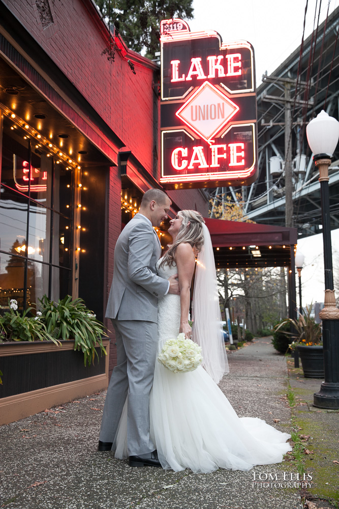 Bride and groom hug during their first-look before their Seattle wedding ceremony, outside the Lake Union Cafe