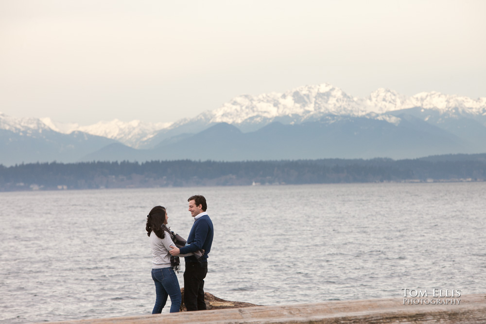 Engaged couple on the beach at Golden Gardens Park in Seattle