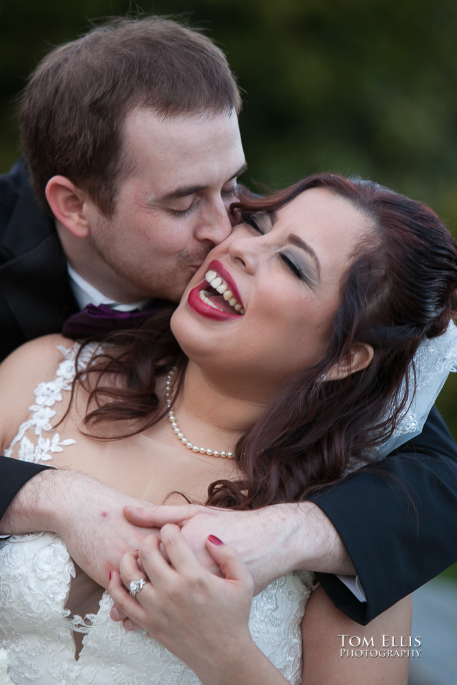 Close up photos as groom hugs laughing bride from behind while he gives her a kiss on the cheek