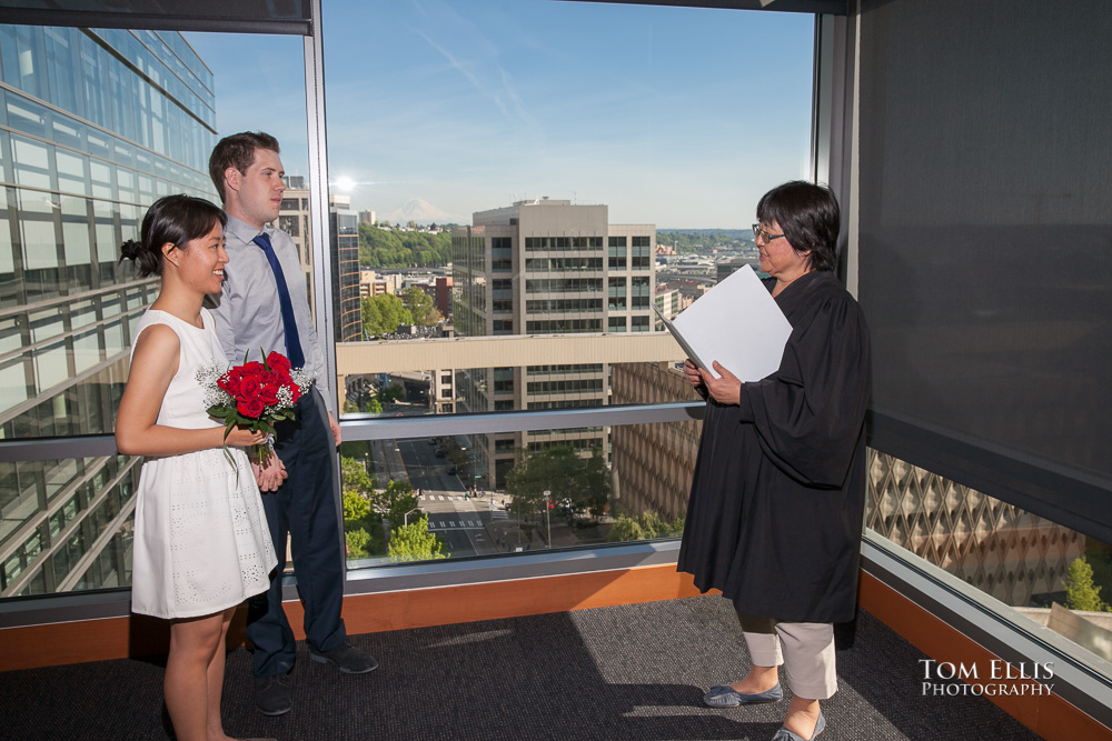 Couple being married by judge at the Seattle Municipal Courthouse