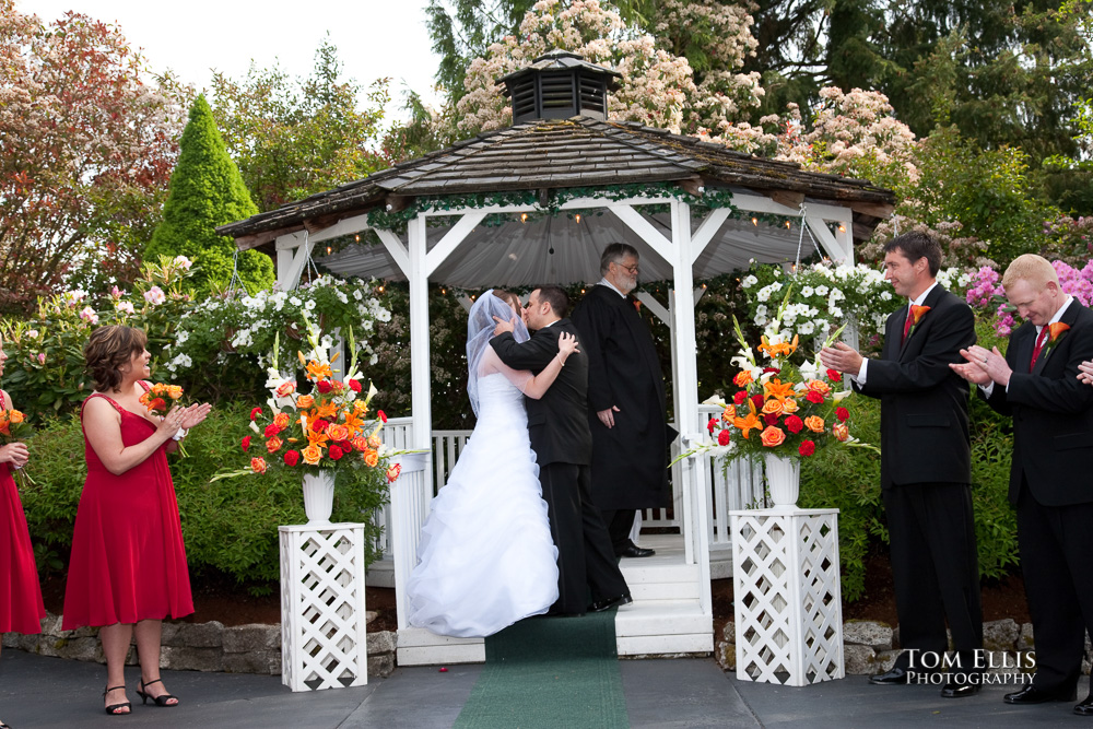 Bride and groom kiss at the end of their wedding ceremony at Leifer Manor