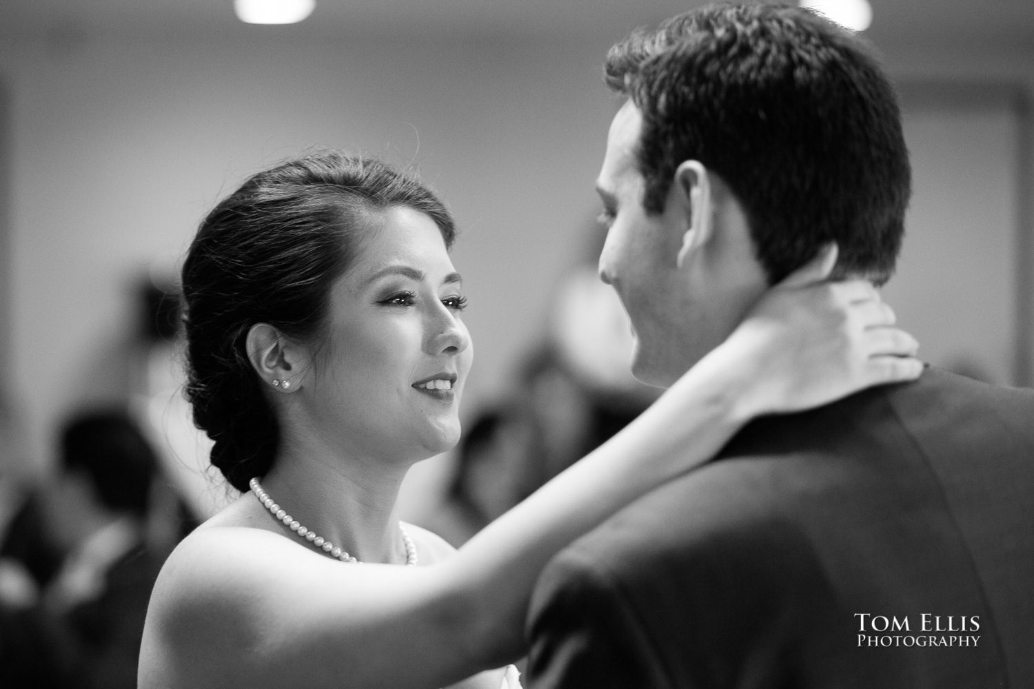 Black and white photo of bride and groom's first dance as a newly married couple