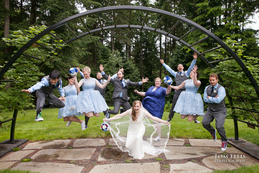Wedding party jumps for joy at an outdoor wedding ceremony at Dragonfly Retreat