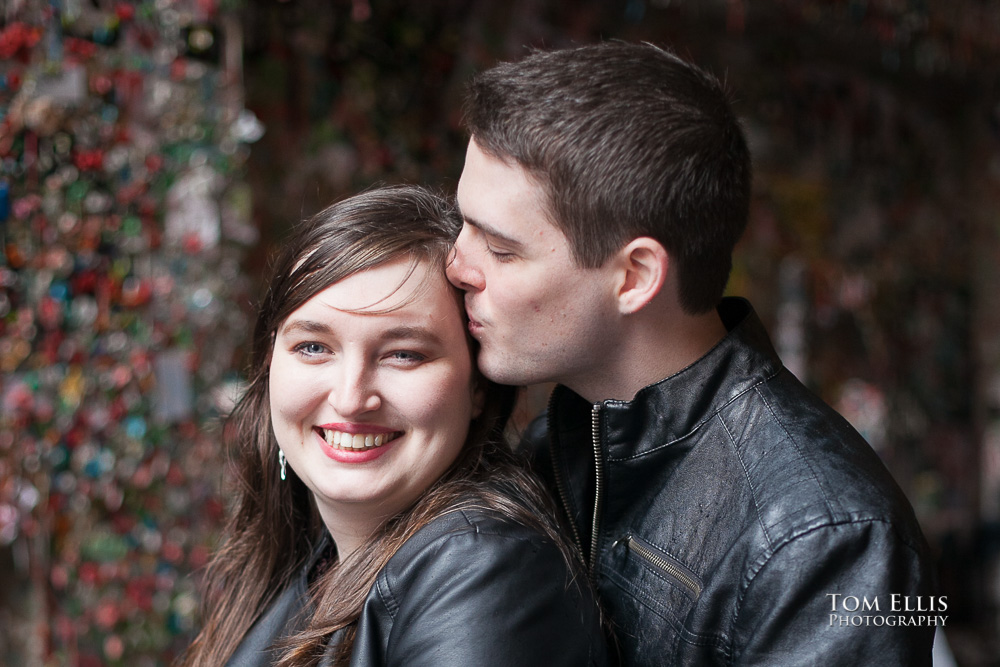 Seattle engagement photo, close up shot of couple in front of the Gum Wall at Pike Place Market