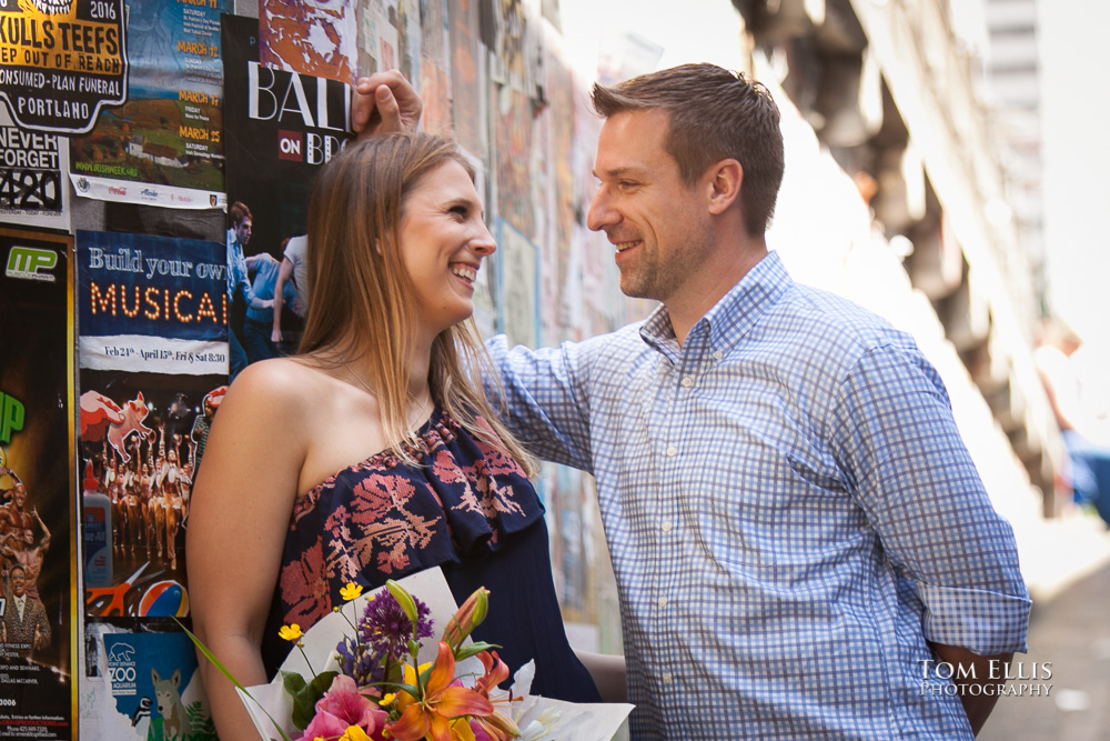 Seattle engagement photo at Pike Place Market, couple talking together in Post Alley