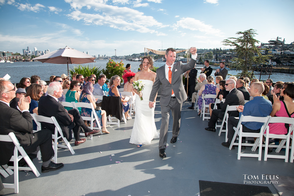 Bride and groom come down the aisle together at the conclusion of their Seattle wedding ceremony on the Skansonia Ferryboat