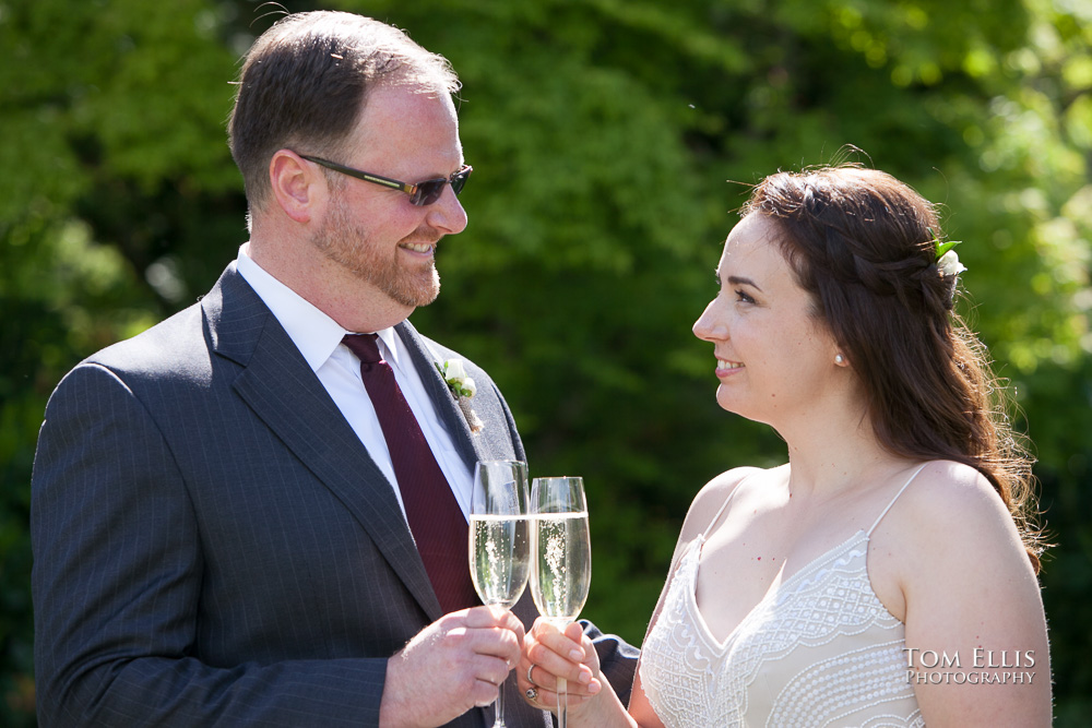 Willows Lodge elopement wedding, bride and groom toast with champagne