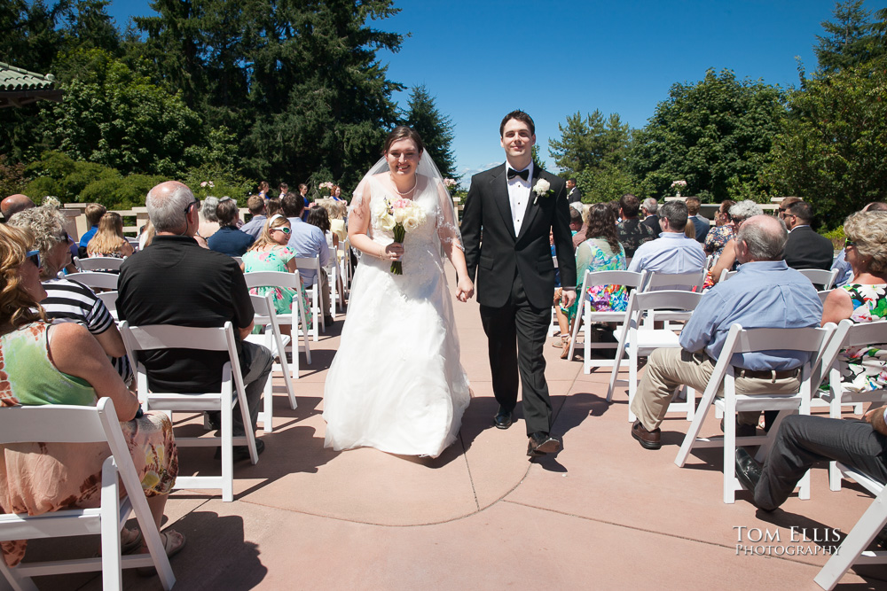 Bride and groom recess down the aisle at the conclusion of their wedding ceremony at the Pagoda in Point Defiance Park