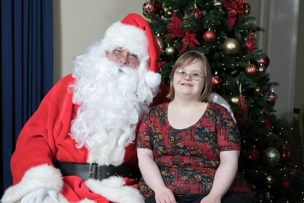 Santa poses with young woman with Down Syndrome at the 2017 Special People's Holiday Cruise