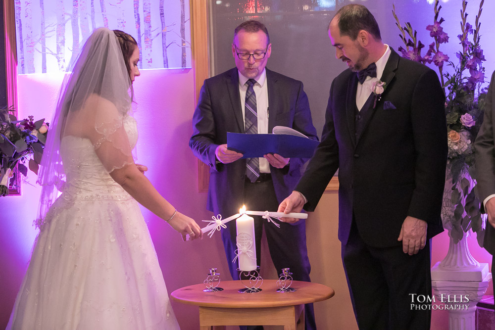 Bride and groom light their Unity Candle during their Seattle area wedding ceremony at Bistro 76 Cafe and Catering