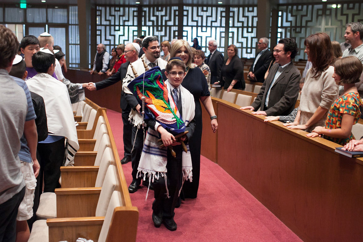 Eli and mother carrying the torah at Seattle Bar Mitzvah at Temple de Hirsh Sinai