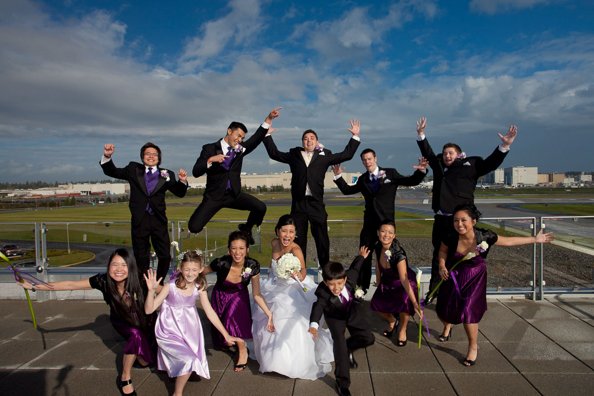 Wedding party getting crazy on the rooftop at Future of Flight museum in Mukilteo