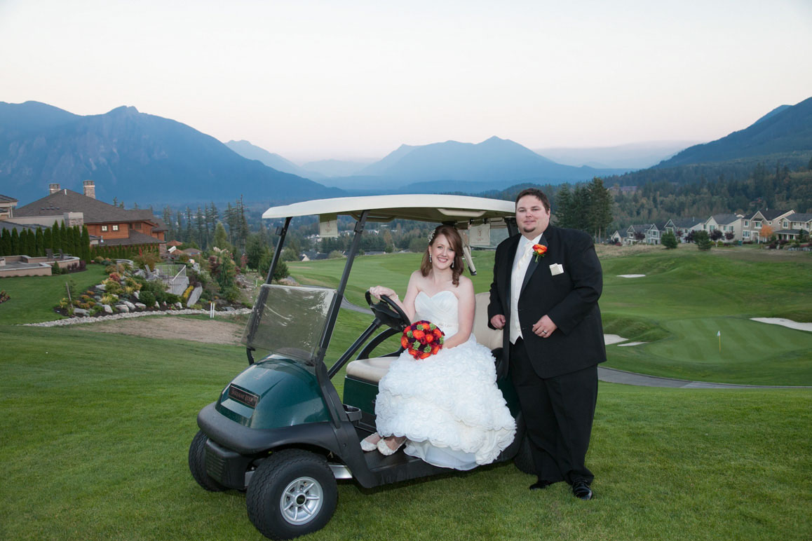 Bride and groom with golf cart, Mt. Si in the background, at Snoqualmie Ridge