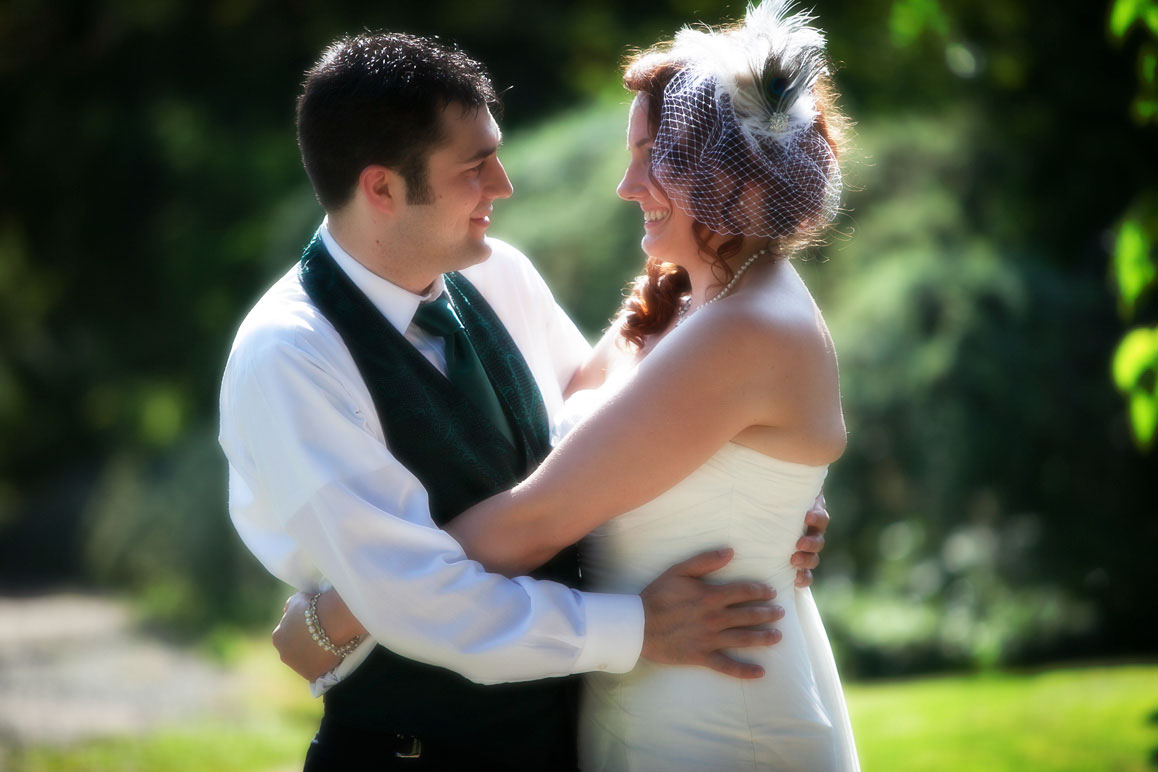 Backlit photo of bride and groom hugging at Kubota Garden in Seattle