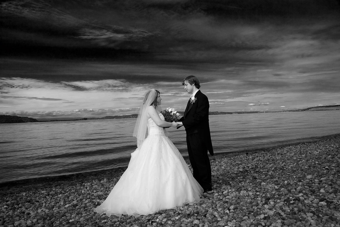 Black and white photo of bride and groom on the beach at the Tacoma Narrows