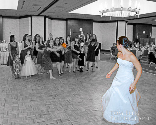 Bride tossing bouquet at Bellevue Hilton wedding