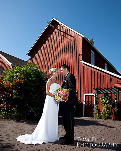 Bride and groon outside red barn at Pickering Barn in Issaquah
