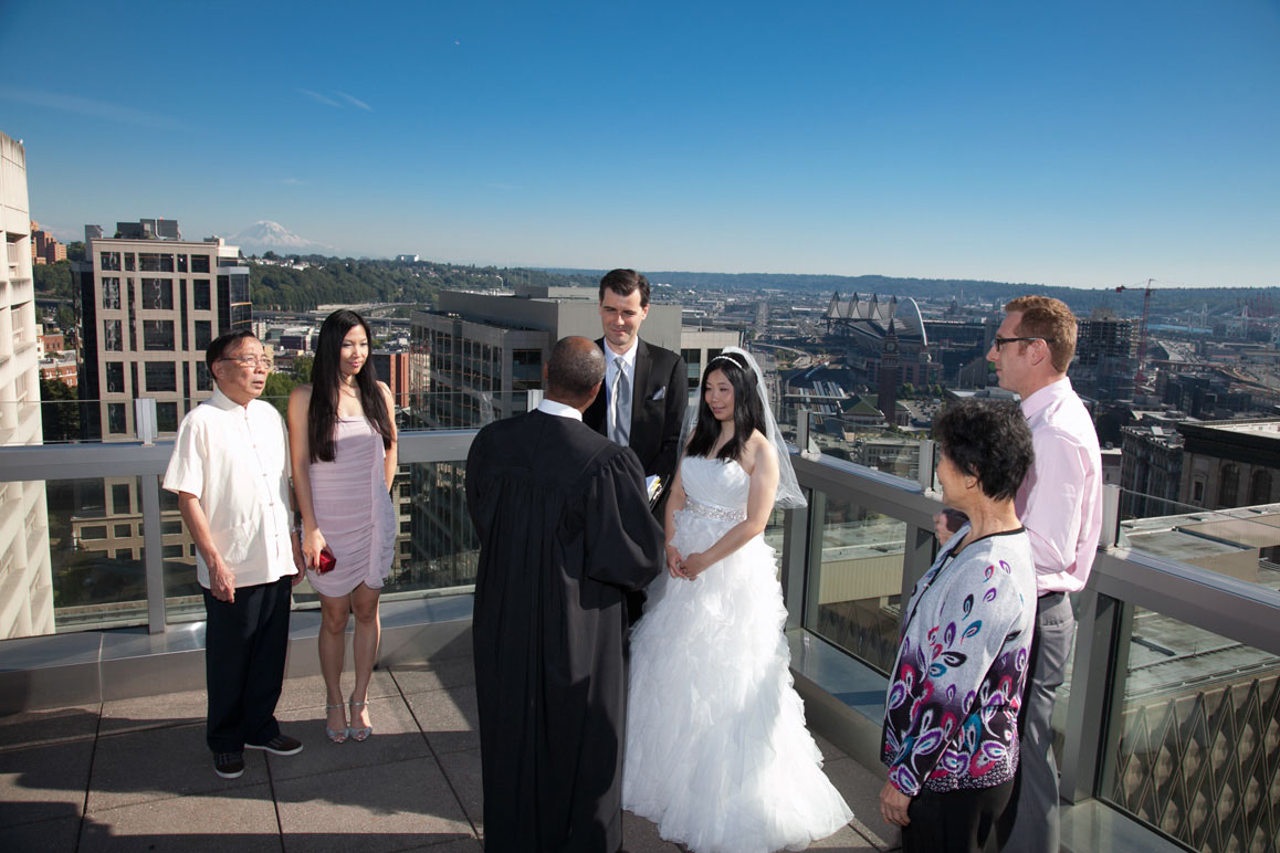 Seattle municipal courthouse rooftop wedding, with scenic view of Seattle and Mt Rainier